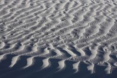 Texture of white sand dunes Stock Images