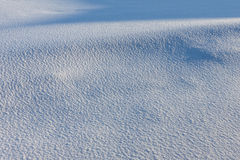 Texture of white snow with blue shadows Royalty Free Stock Images