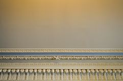 Texture of white stone ceiling with patterns and beautiful plaster moldings. The background stock image