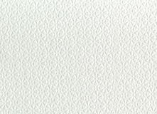 Texture of white tissue paper, background or texture. Close up of embossed flower pattern on paper. White abstract background with subtle delicate grunge Royalty Free Stock Photo