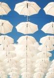 Texture of white umbrellas in the sky Stock Photo