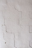 The texture on the white wall. Cracks, roughness Royalty Free Stock Photos