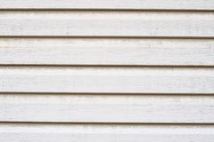 Texture of white wooden siding. Old wooden panels covered with d Royalty Free Stock Image