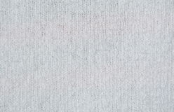 Texture of white woolen fabric. The texture of white woolen fabric royalty free stock image