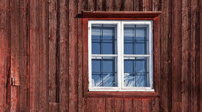 Texture of a window on the old red wooden wall Royalty Free Stock Photo