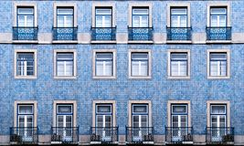 Texture of the windows. Lisbon windows with typical portuguese tiles on the wall Royalty Free Stock Photography