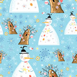 Texture of winter snowmen and trees. Seamless pattern of winter snowmen and trees on a blue background with snowflakes Royalty Free Stock Image