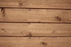 Texture wood. Abstract background showing fragment of surface of a wooden house wall of planking with nails and wood texture / pattern closeup. Landscape Royalty Free Stock Photo