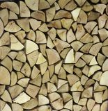 Texture of wood, abstract wooden wall of woodpile royalty free stock images