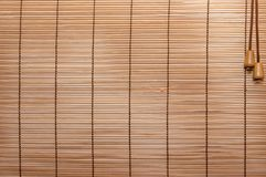 Texture wood blinds stitched rope. Identical strips of wood, thin stock photos