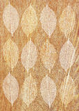 Texture of wood with decorative leaves Royalty Free Stock Photography