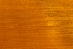 Texture of wood, oak, under varnish. Red orange close-up stock photography