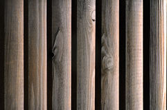 Texture of wooden boards brown. Texture of wooden boards brown illuminated from the back side. Shutters closeup Stock Image
