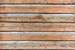 The texture of wooden boards. A fence made of boards. The wall of wooden house stock photography
