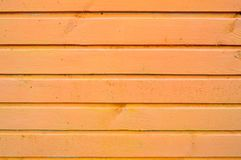 The texture of wooden boards is yellow with seams horizontally painted with natural paint. The background royalty free stock photo