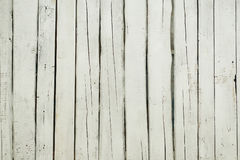Texture of wooden fence. With a cracked white paint Stock Images