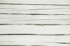 Texture of wooden fence. With a cracked white paint Stock Photos