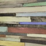 Texture of a wooden fence in multi-colored stripes with narrow boards stock photo