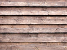 Texture of a wooden fence with a new horizontal brown background Stock Photos