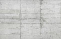 Texture of wooden formwork stamped on a raw concrete wall. Texture of wooden form work stamped on a raw concrete wall as background Royalty Free Stock Photography