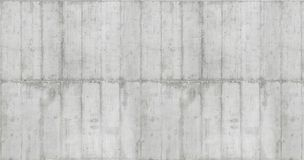 Texture of wooden formwork stamped on a raw concrete wall. Texture of wooden form work stamped on a raw concrete wall as background Stock Photography