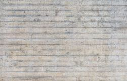 Texture of wooden formwork stamped on a raw concrete wall Stock Images