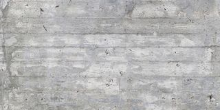 Texture of wooden formwork stamped on a raw concrete wall. Texture of wooden form work stamped on a raw concrete wall as background Stock Images