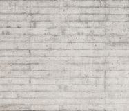 Texture of wooden formwork stamped on a raw concrete wall. Texture of wooden form work stamped on a raw concrete wall as background Royalty Free Stock Image