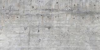 Texture of wooden formwork stamped on a raw concrete wall. Texture of wooden form work stamped on a raw concrete wall as background Royalty Free Stock Photos