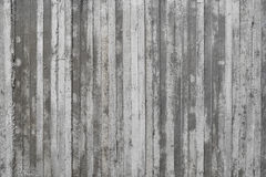 Texture of wooden formwork stamped on a raw concrete wall Stock Photo