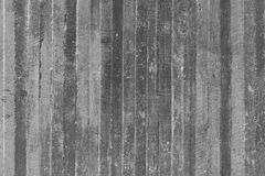Texture of wooden formwork stamped on a raw concrete wall Stock Photography