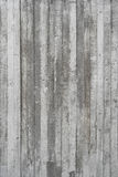 Texture of wooden formwork stamped on a raw concrete wall Stock Image