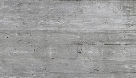 Texture of wooden formwork stamped on a raw concrete wall. Texture of wooden form work stamped on a raw concrete wall as background Stock Image