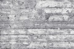 Texture of wooden formwork stamped on a raw concrete wall Royalty Free Stock Photos