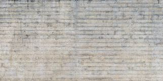 Texture of wooden formwork stamped on a raw concrete wall. Texture of wooden form work stamped on a raw concrete wall as background Royalty Free Stock Images