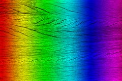 Texture of wooden plank, spectrum painted, close-up stock photos