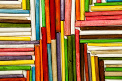Texture of wooden sticks colored. Direction towards the center. Texture of many colorful wooden sticks. The twigs of wood depart or arrive from the center stock photo
