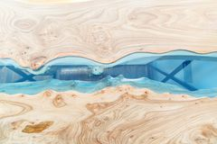 Texture of a wooden table with epoxy resin. Top view of wood for background.  stock photo