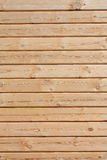 Texture of wooden wall. Horizontal parallel lines formed by wooden beams Royalty Free Stock Images