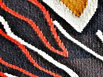Texture of a wool carpet. Natural wool carpet with handmade patterns. Texture stock images