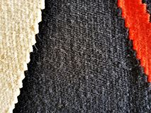 Texture of a wool carpet. Natural wool carpet with handmade patterns. Texture royalty free stock image