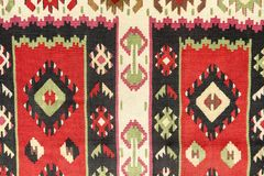 Texture of the wool carpet. With geometric decorations stock image