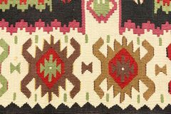 Texture of the wool carpet. With geometric decorations stock photography