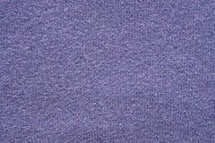 Texture from a wool yarn of violet color Stock Images