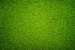 Texture woolen fabric green color Stock Images