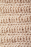 Texture of woolen knitted beige scarf Royalty Free Stock Image