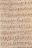 Texture of woolen knitted cream scarf Royalty Free Stock Photo