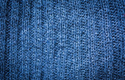 Texture of woolen material. Background with a blue knitted pattern. royalty free stock images