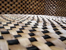 Texture of woven boxes. These are woven from seagrass. They are boxes that are woven and  thus porous. They are actually three boxes in shot. Used to keep Royalty Free Stock Photos