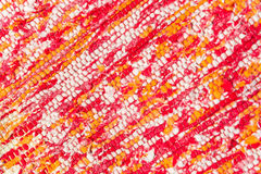 Texture of woven cotton red, pink, white, yellow threads Royalty Free Stock Images